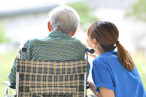patient and nurse glancing out window