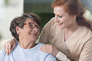 patient and nurse smiling at one another