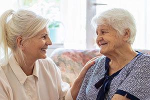 patient and nurse smiling