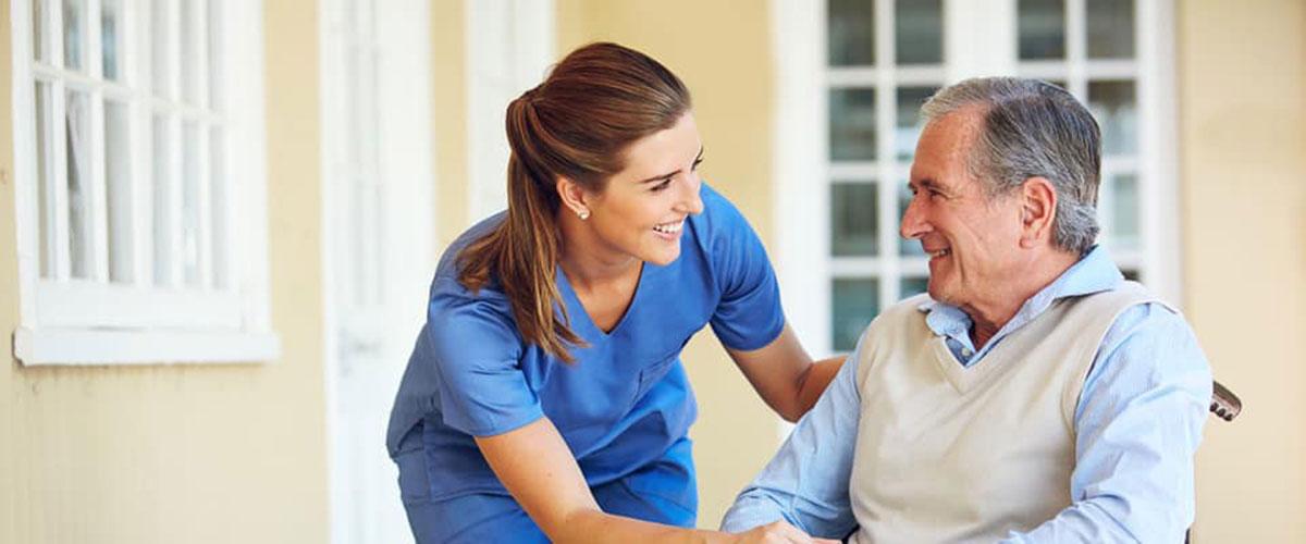Seasons Largo nurse assisting patient
