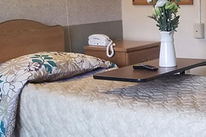 image of a bedroom with cord phone