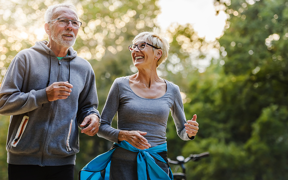 senior couple happily jogging on nice day